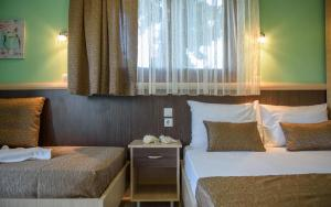 Rodon Garden, Apartments  Sarti - big - 15