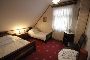 Kiermusy Dworek nad Łąkami, Guest houses  Kiermusy - big - 13