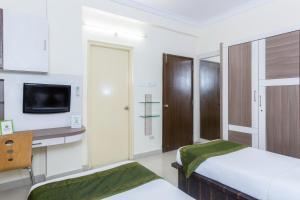 Treebo Hitec City, Апарт-отели  Хайдарабад - big - 6