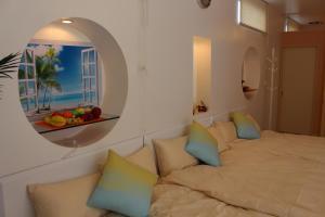 Nirai Beach Villa, Дома для отпуска  Yomitan - big - 86
