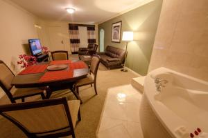 Deluxe King Suite  with Pool View