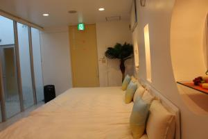 Nirai Beach Villa, Дома для отпуска  Yomitan - big - 79