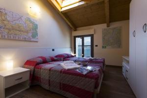 Casa Attico Al Porto, Ferienwohnungen  Pianello Del Lario - big - 18