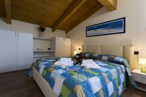 Casa Attico Al Porto, Ferienwohnungen  Pianello Del Lario - big - 11