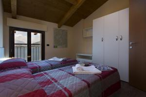 Casa Attico Al Porto, Ferienwohnungen  Pianello Del Lario - big - 26