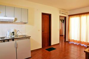 Iolkos Hotel Apartments, Apartmanhotelek  Káto Daráco - big - 11