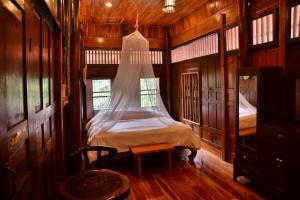 Dvoulůžkový pokoj typu Superior s manželskou postelí a společnou koupelnou
