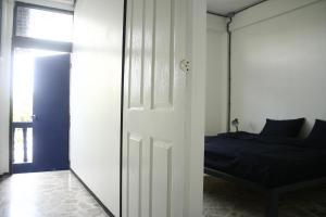 Dvoulůžkový pokoj s manželskou postelí a balkónem
