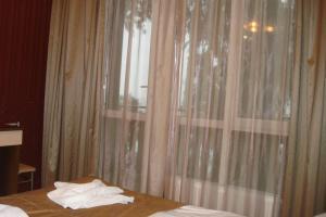 Guest house Skazka, Гостевые дома  Гагра - big - 32