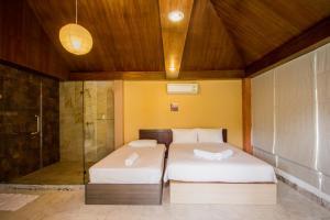 Tamnak Beach House, Ferienhäuser  Na Jomtien - big - 17