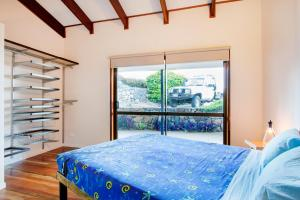 Heliconia on Kara, Prázdninové domy  Airlie Beach - big - 25