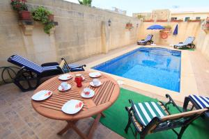 Ta' Bejza Holiday Home with Private Pool, Dovolenkové domy  Xewkija - big - 18