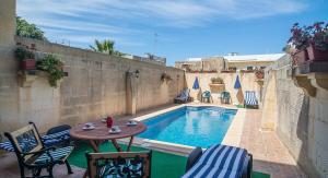 Ta' Bejza Holiday Home with Private Pool, Holiday homes  Xewkija - big - 21