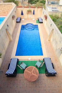Ta' Bejza Holiday Home with Private Pool, Holiday homes  Xewkija - big - 20