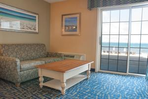 Deluxe King Room with Sofa Bed - Beach View