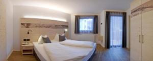 Rautal Apartments, Апартаменты  Сан-Виджилио-ди-Мареббе - big - 6