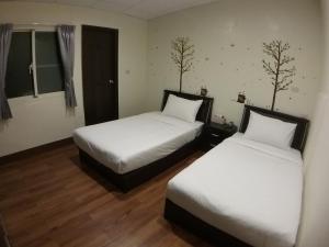 Malaya Guest House, Homestays  Budai - big - 5