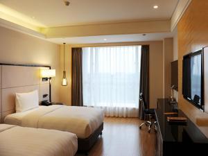 Pullman Qingdao Ziyue, Hotels  Qingdao - big - 25