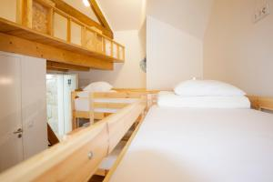 Bed in 8-Bed Female Dormitory Room with Private Bathroom