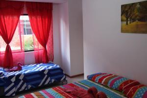 Habitaciones en Medellín (Apartahotel Ferjaz), Гостевые дома  Медельин - big - 138