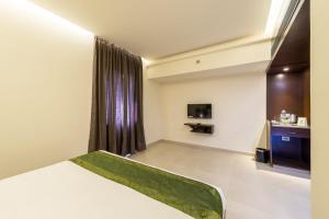 Treebo Grand Premier Suites, Hotels  Bangalore - big - 33