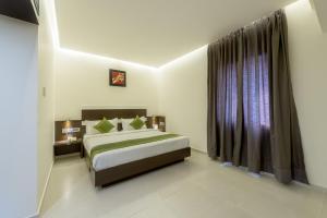 Treebo Grand Premier Suites, Hotely  Bangalore - big - 39