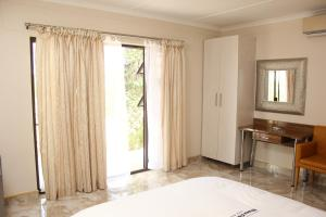 Etuna Guesthouse Court, Pensionen  Ongwediva - big - 17