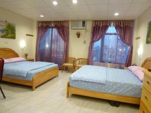 Sun Moon Star Hostel, Проживание в семье  Budai - big - 9