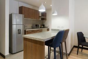 Suites Metropoli Bristol Park, Апартаменты  Кито - big - 58