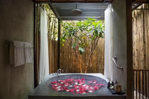 This Suite Boasts A Separate Living Area Dining And Terrace Its Semi Outdoor Bathroom Is Complete With An Over Sized Bathtub Rain Shower