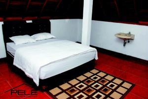 Pele Guesthouse, Penzióny  Bandung - big - 3