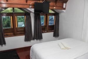Pele Guesthouse, Penzióny  Bandung - big - 5