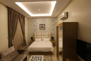 Dorrah Suites, Aparthotels  Riad - big - 6