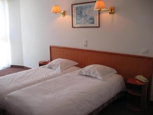 Hotel Les Arcades, Hotely  Saint-Cast-le-Guildo - big - 13