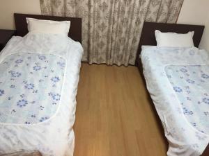 Naniwa Guest House Kuromon, Apartmanok  Oszaka - big - 9