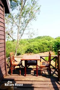 Nature House, Комплексы для отдыха с коттеджами/бунгало  Banlung - big - 21