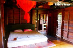 Nature House, Комплексы для отдыха с коттеджами/бунгало  Banlung - big - 14