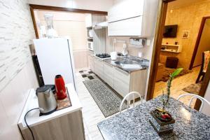 Apartamento Aconchegante Na Serra, Apartmány  Gramado - big - 39