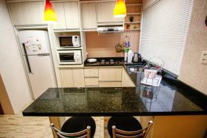 Apartamento Aconchegante Na Serra, Apartmány  Gramado - big - 8