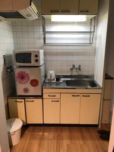 Naniwa Guest House Kuromon, Apartmanok  Oszaka - big - 19