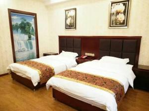 Nidacuo Business Inn, Отели  Yajiang - big - 4