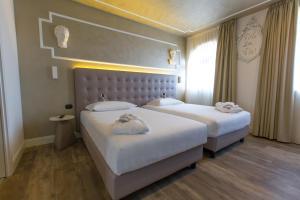Al Campanile-Aparthotel & Suite - AbcAlberghi.com
