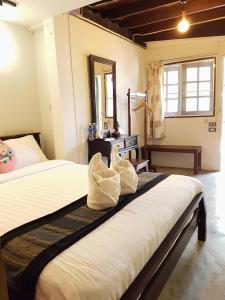 Dvoulůžkový pokoj Deluxe s manželskou postelí a terasou