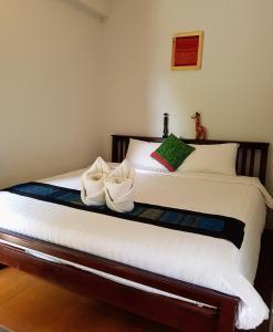 Dvoulůžkový pokoj Standard s manželskou postelí a koupelnou mimo pokoj