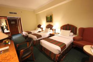 Двухместный номер Делюкс с 2 отдельными кроватями + дополнительной кроватью