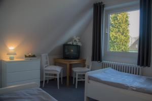 Holiday home in Hage/Nordsee 2624, Nyaralók  Hage - big - 11