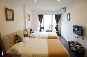 Chongqin Rongshuxia Youpin Apartment, Apartments  Chongqing - big - 6