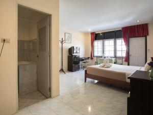 Stefan's Guesthouse, Penziony  Jomtien - big - 8
