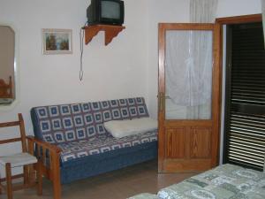 Pensión Las Tres Golondrinas, Vendégházak  Es Figueral Beach - big - 18