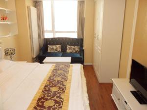 Dalian Xinshijia Ganghui Service Apartment, Апартаменты  Далянь - big - 6